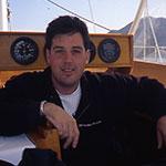 3.-Greg-Reitman-on-Basil-Poledouris-saliboat